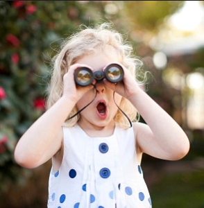 surprised girl with binoculars